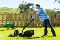 Young man mowing lawn Royalty Free Stock Photography