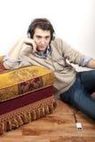 Young man mp3 music headphones Royalty Free Stock Photos