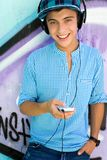 Young man with mp3 player Royalty Free Stock Photo