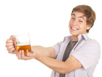 Young man with mug of beer Royalty Free Stock Photos