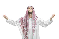 Young man of muslim religion praying. Isolated on white background royalty free stock images