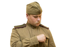 Young man with a mustache in soviet uniform Stock Image