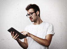 Young man with mustache use digital tablet Stock Images