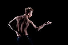 Young man naked torso in jeans. In dark Royalty Free Stock Image