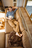 Young man napping on his couch Stock Photography