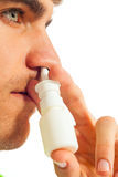 Young man with nasal spray Stock Image