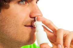 Young man with nasal spray Stock Photos