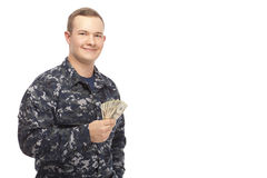 Young man in navy uniform with money Royalty Free Stock Images