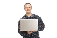 Young man in navy uniform using laptop Stock Images