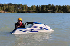 Young man near his jet ski. Stock Images