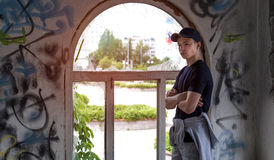 Young man near an old broken window. Young man stands near an old broken window Royalty Free Stock Photos
