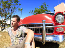 Young man  near old vintage car Royalty Free Stock Images