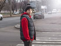 Young man near the pedestrian crossing royalty free stock photo
