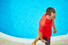 Young man near the pool Royalty Free Stock Photography