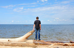 Young man near the sea Stock Photos