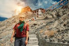Young man near the tibetan monastery Tsemo Gompa in Leh, North I Royalty Free Stock Photography