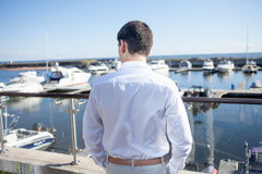 Young man near the yacht club,  view from  back Royalty Free Stock Photos