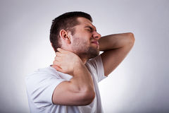 Young man with neck ache Stock Photos