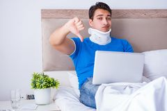 The young man with neck injury in the bed. Young man with neck injury in the bed Royalty Free Stock Images