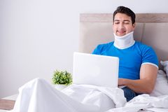 The young man with neck injury in the bed. Young man with neck injury in the bed Royalty Free Stock Photo