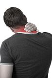 Young Man with neck pain. Young man holding his neck in pain Royalty Free Stock Image