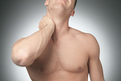 Young man with neck pain Stock Image