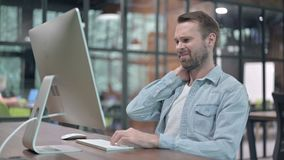 Young man with neck pain at work. The young man with neck pain at work stock video footage