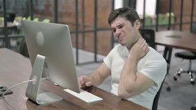 Young man with neck pain at work. The young man with neck pain at work stock footage