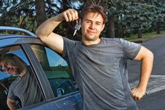 Young man with new car Royalty Free Stock Photography