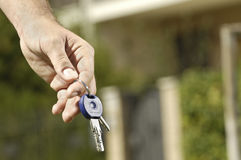 Young man and new home, door key in hand Stock Photos