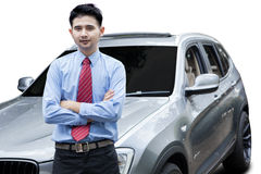 Young man with new luxury car Stock Images