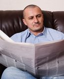 Young man with newspaper Royalty Free Stock Photo