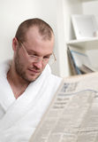 Young man with newspaper Royalty Free Stock Images