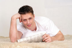 Young man with newspaper Royalty Free Stock Photos