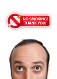 Young man with NO SMOKING sign over his head 2 Royalty Free Stock Photos