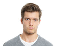 Young man is not happy. Young man making a face Stock Images