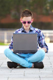 Young man with a notebook smiling Royalty Free Stock Photo