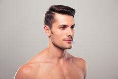 Young man with nude torso looking away Royalty Free Stock Photos