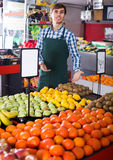 Young man offering fruits Stock Photography