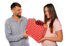Young man offering a gift to his girlfriend Royalty Free Stock Photo