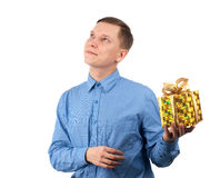 A young man offering a gift to you Stock Image