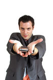 Young man offering giving cellphone. A young businessman, holding a cellphone(mobile) on his spread palms with hands pointing forward Royalty Free Stock Images