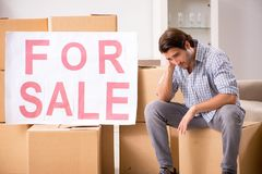 The young man offering home for sale and moving out royalty free stock images