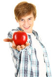 Young man offering a red apple. Young man in casual shirt offering a red apple Stock Images