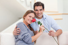 Young man offering a rose to his girlfriend Stock Photo