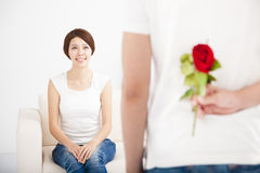Young Man offering  rose to his girlfriend Royalty Free Stock Photos