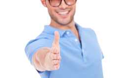 Young man offering to shake hands Royalty Free Stock Images