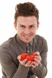 Young man offering tomatoes Royalty Free Stock Photos