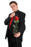 Young man offering you a rose Royalty Free Stock Photo