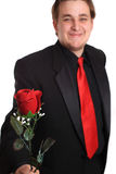 Young man offering you a rose Royalty Free Stock Images
